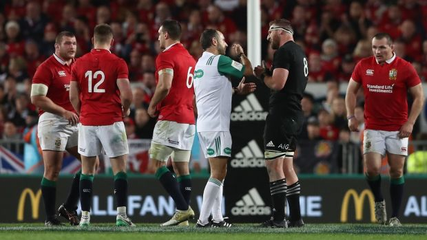 Romain Poite talks to All Black captain, Kieran Read after he reverses his penalty decision. Photograph: David Rogers/Getty Images