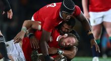 Lions secondrow Alun Wyn Jones takes a blow to the head in a tackle from All Blacks backrow Jerome Kaino during the third Test at Eden Park in Aukland. Photograph:  Hannah Peters/Getty Images