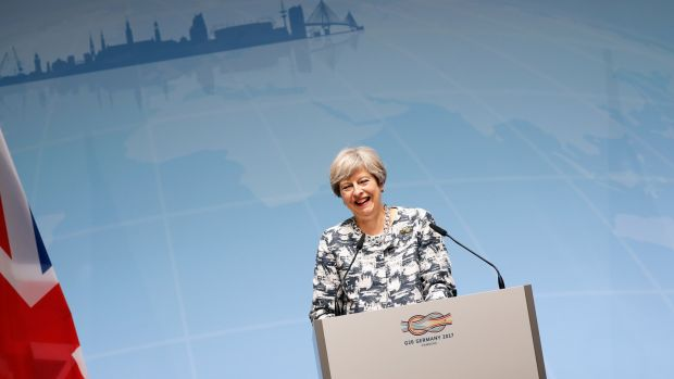 British prime minister Theresa May adopted a middle position on trade between the US and other G20 members, insisting that London stood by the status quo now and into the Brexit future. Photograph: Friedemann Vogel/EPA