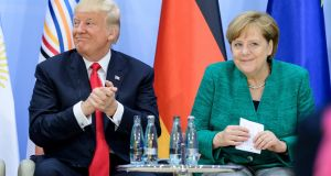 President Donald Trump and German chancellor Angela Merkel on the second day of the G20 summit  in Hamburg. Photograph:Ukas Michael/Pool/Getty Images
