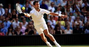 Novak Djokovic in action against Ernests Gulbis during their third-round clash at Wimbledon. Photograph:  John Walton/PA Wire