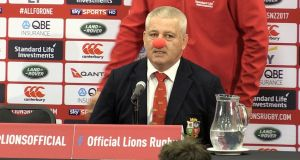 British and Irish Lions coach Warren Gatland wears a red nose during a press conference after the third  Test match at Eden Park in Auckland. Photograph:   Marty Melville/AFP/Getty Images