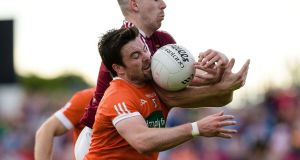 James Dolan and Aidan Forker compete for possession. Photograph: Inpho
