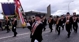 Orangemen on Garvaghy Road on their way to Drumcree in 2000. Photograph: Bryan O'Brien