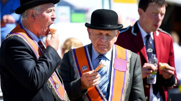 Orangemen eat ice cream after taking part in the annual pre-Twelfth of July parade in Rossnowlagh. Photograph: Jeff J Mitchell/Getty Images