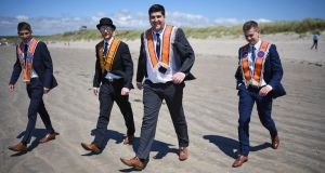 Orangemen take a walk on  the beach at  Rossnowlagh. Photograph: Jeff J Mitchell/Getty Images