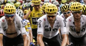 Geraint Thomas (second from right) pictured beside yellow jersey holder and Sky team-mate Chris Froome  at the start of stage nine of the Tour de France. The Welsh rider broke a collarbone during the stage and is out of the race. Photograph: Philippe Lopez/AFP/Getty Images