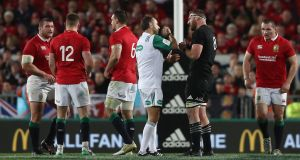 Referee Romain Poite explains to All Blacks captain Kieran Read his decision not to award a penalty in the closing stages   of the third Test against the Lions at Eden park in Auckland. Photograph:  David Rogers/Getty Images