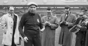 Béla Guttmann: the  flawed, uniquely gifted Benfica coach – shown with journalists in London in 1962 – negotiated a path through the horrors of Nazism. Photograph: Keystone/Hulton/Getty