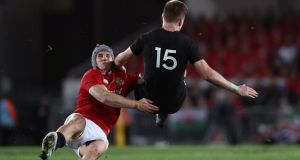 "All Blacks' Jordie Barrett  is tackled by ""Lions of the Tour"" Jonathan Davies  in the third Test match which ended in a 15-15 draw. Photograph:  David Rogers/Getty Images"