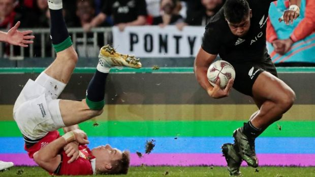 All Blacks winger Julian Savea in action against Lions' Liam Williams. Photograph: Jason Reed/Reuters