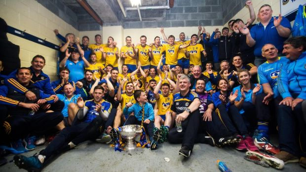 Roscommon celebrate after the game in the changing room with the trophy. Photograph: Inpho