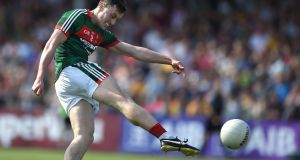 Mayo's Diarmuid O'Connor attempts a shot on goal during the All-Ireland SFC  Qualifiers 3A match at Cusack Park, Ennis. Photograph: Inpho
