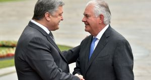 Ukraine's president Petro Poroshenko and US secretary of state Rex Tillerson greet each other in  Kiev on July 9th, 2017.  Photograph: Sergei SUPINSKY/AFP/Getty Images