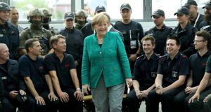 German chancellor Angela Merkel thanks members of German law enforcement and emergency services at the conclusion of the G20 summit in Hamburg. Photograph: Sean Gallup/EPA