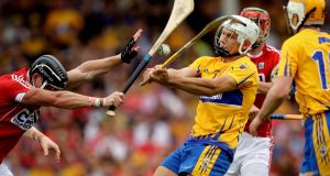 Clare's John Conlon gets his shot away under pressure from Cork's Colm Spillane during Sunday's Munster hurling final at Semple Stadium, Thurles.Photograph: Ryan Byrne/Inpho