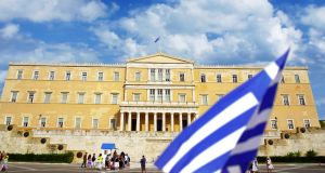 The Greek parliament in Athens. the government is exploring whether funds from the public investment budget can be transferred to the new lender. (Photograph: iStock)