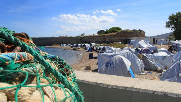 Souda camp: the rocky beach in front of the camp on the Greek island of Chios is a sea of tents, full of new arrivals for whom it has no room. Photograph: Jennifer Hough