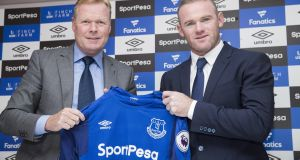Everton boss Ronald Koeman with the returning Wayne Rooney. Photograph: Mark Robinson/Getty