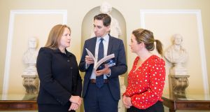 Minister for Health Simon Harris (centre) discusses the chair of the working group Deborah McNamara  (left) and consultant in general and colorectal surgery at Beaumont Hospital,  and Dr Ailin Rodgers, senior surgical trainee at the RCSI (right). Photograph: Julien Behal