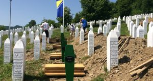 Preparations for Tuesday's commemoration of the 1995 Srebrenica massacre, when 71 newly identified victims were due to be buried alongside most of the 8,000 other Bosnian Muslims murdered during the genocide by Bosnian Serbs. Photograph: Daniel McLaughlin