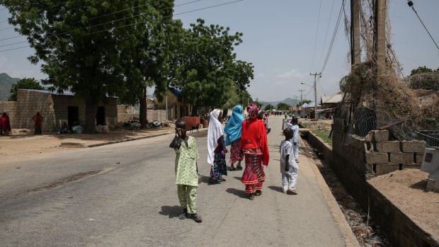 Girls walk about in central Gwoza, Borno State, northeast Nigeria. Photograph: Sally Hayden