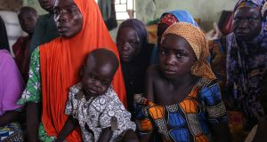 Recently returned people sit in a camp for the displaced in Gwoza, Borno State, northeast Nigeria. Photograph: Sally Hayden