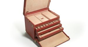 Bespoke, brass-mounted red leather travelling case, made in Italy and to store and transport Edward Haughey's cufflinks went for €1,195 at Sotheby's