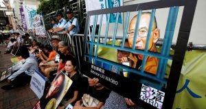 Pro-democracy activists stage a sit-in protest demanding the release of Nobel laureate Liu Xiaobo, outside China's Liaison Office in Hong Kong. Photograph: Bobby Yip/Reuters