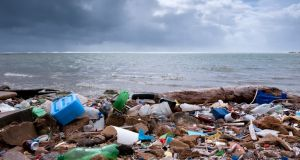 A beach strewn with waste. One million plastic bottles are bought every minute around the world. Photograph: Getty