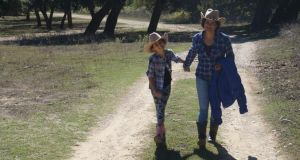 Learning to live a cowboy life: Sarah McKevitt with her daughter Izzie in Houston.