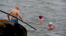 Meet the 'early risers' - the swimmers who clean up Sandycove