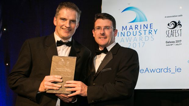 Eamonn Confrey, DCCAE, the Principal Officer of the Decarbonisation Division, presents the Excellence in Marine Renewable Energy Award to Jimmy Murphy, Lir National Ocean Test Facility.