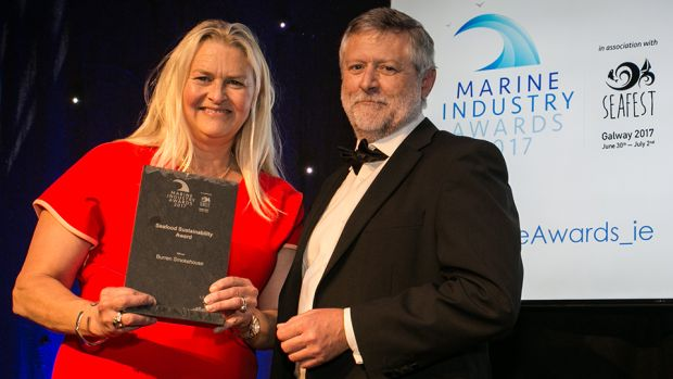 Dr. Dave Jackson, Inspector of Fisheries and manager of the Aquaculture Section in the Marine Institute. presents the Seafood Sustainability Award to Birgitta Hedin-Curtin, Burren Smokehouse.