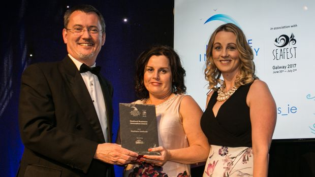 Jim O'Toole, CEO, Bord Iascaigh Mhara, BIM presents the Seafood Business Innovation Award to Jacklyn O' Connor and Liz O' Leary, Keohane Seafoods.