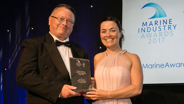 Rory Carberry, Director, Irish Sailing Association presents the Marine Tourism & Leisure Operator of the Year award to Lucy Hunt, Sea Synergy Marine Awareness & Activity Centre.