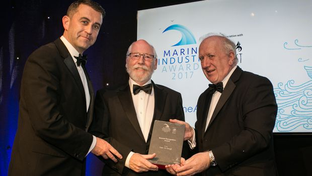 Conor Mowlds and Brendan Tuohy, NMCI presents the Special Recognition Award to Capt. Viv Gough.