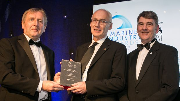 Minister Michael Creed and Peter Heffernan CEO, Marine Institute presents the Excellence in Marine Technology Award to John Murphy, SafeTrx - 8 West Consulting.