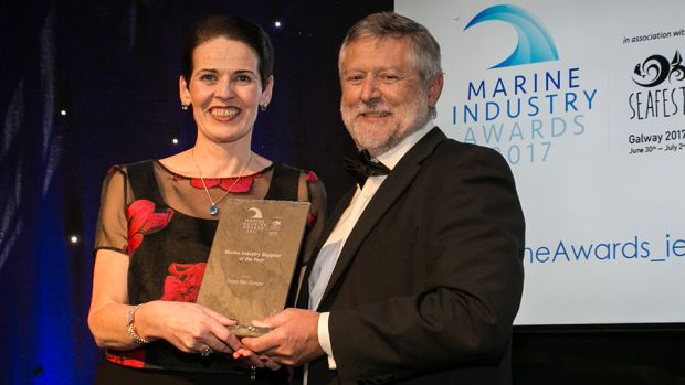 Dr. Dave Jackson, Inspector of Fisheries and manager of the Aquaculture Section in the Marine Institute presents the Marine Industry Supplier of the Year award to Evelyn Kierans, Swan Net Gundry.