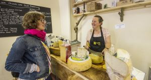 Sinéad Ní Gháirbhith serves a customer in The Cheese Press in Ennistymon, Co Clare