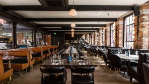 Roberta's:  handsome herringbone timber floor, booths big as hot tubs and expensive chairs