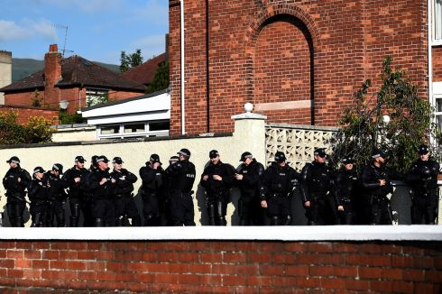 Police officers along the route of a parade in the Ardoyne. Photograph: Clodagh Kilcoyne/Reuters