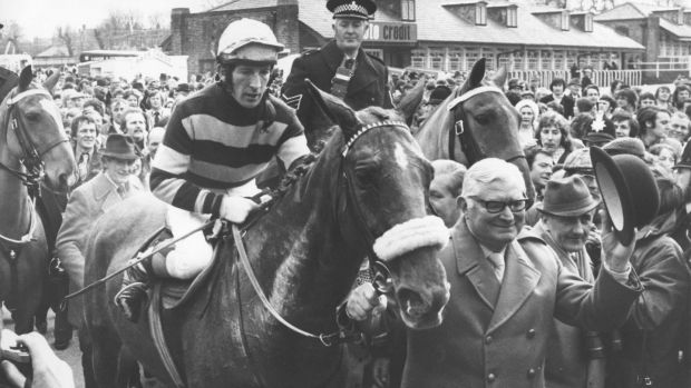 L'Escargot ridden by Tommy Carberry is led in by owner Raymond Guest after winning the Grand National at Aintree in 1975. Photograph: Getty Images