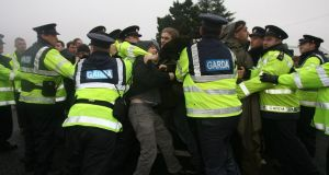 Gardaí engage in a shoving match with protesters outside the Corrib gas terminal site in Ballinaboy, Co Mayo. Photograph: Niall Carson/PA