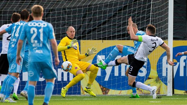 Rosenborg's Tore Reginiussen gets his toe ahead of Gartland to score the equaliser. Photo: Liam McBurney/PA Wire