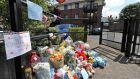 Flowers and cards placed at the entrance to the Riverside Apartments, Poddle Park, Kimmage. Photograph: Colin Keegan/Collins
