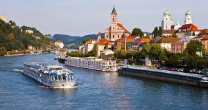 Cruise ship passing on the River Danube in Passau, Bavaria, Germany