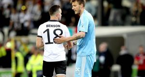 Dundalk's Robbie Benson with Nicklas Bendtner of Rosenborg. Photograph: Inpho