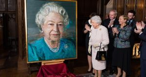 Martin McGuinness attends the unveiling by  Queen Elizabeth of a portrait of  herself, in London last November. Photograph: Jeff Spicer/Getty Images