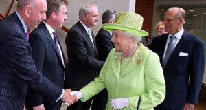 Queen Elizabeth shakes hands with Peter Sheridan from Co-operation Ireland, as Prince Philip meets Martin McGuinness, then Northern Ireland deputy first minister,  at the Lyric Theatre in Belfast in 2012. Photograph: Paul Faith/AFP/GettyImages